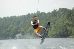Wakeboarder jumps the wake.